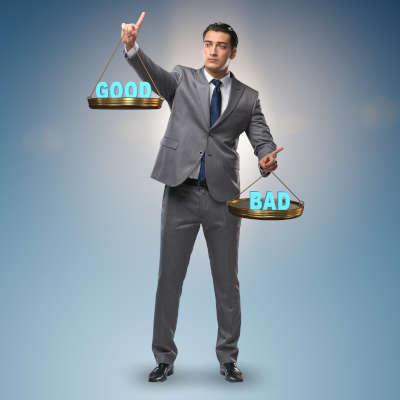 Business man choosing between good and bad