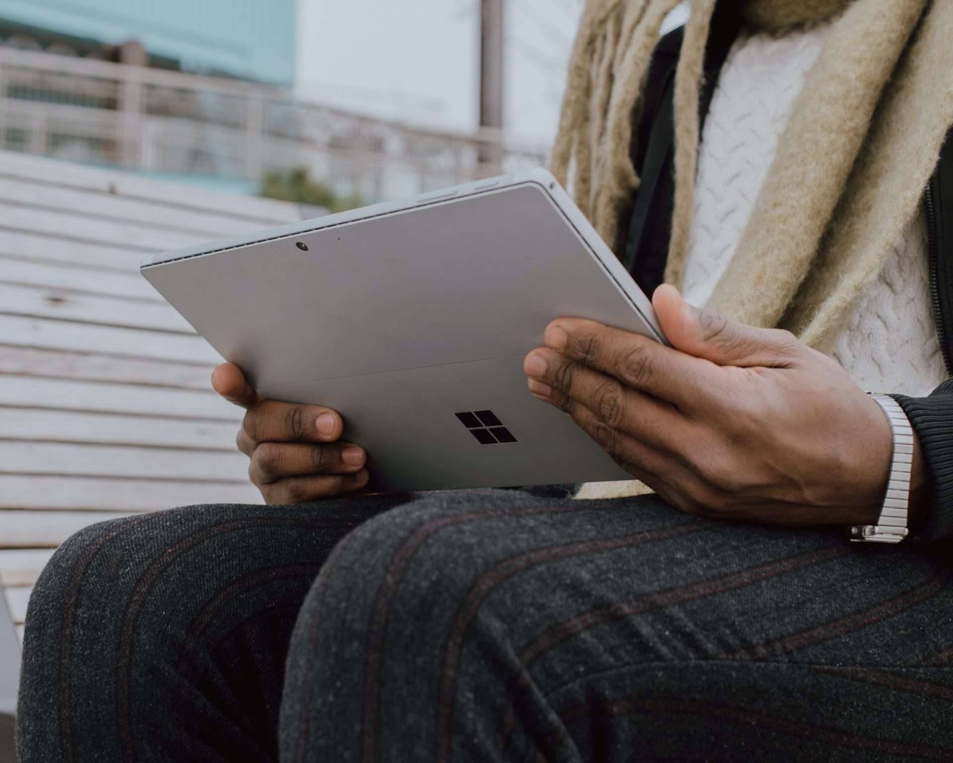 Person holding a Microsoft tablet